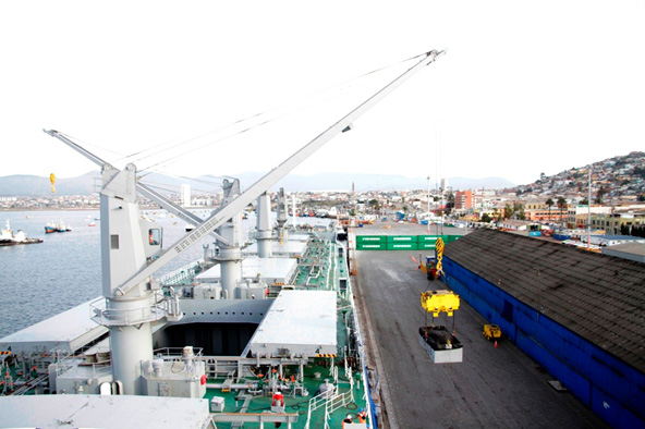 Loading the initial shipment of Caserones copper concentrate onto the Koryu carrier ship