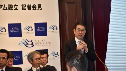 Masaki Saito, Chief Operating Officer of IT & Communication Business Unit at Mitsui & Co., Ltd. giving a speech